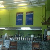 Photo taken at Pura Vida Cafe by Mark D. on 7/5/2012