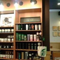 Photo taken at Starbucks by เสกสรร ว. on 4/3/2012