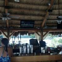 Photo taken at Bamboo Beach Tiki Bar & Cafe by Seth S. on 6/21/2012
