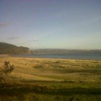 Photo taken at Tralee Beach by Daniel M. on 3/31/2012