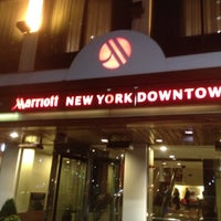 Photo taken at New York Marriott Downtown by Toby S. on 6/8/2012