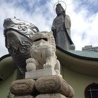 Photo taken at 万国霊廟長崎観音 by Maiko U. on 4/20/2012