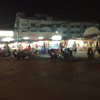 Photo taken at ตลาดนัดหน้าหมู่บ้าน by Sabrin E. on 3/22/2012