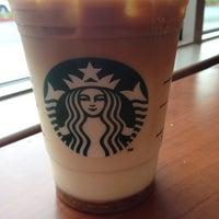 Photo taken at Starbucks by Erica M. on 3/16/2012