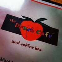 Photo taken at The Peach Café by H T. on 4/1/2012