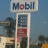 Photo taken at Mobil by Askingforafriend on 3/16/2012