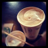 Photo taken at Starbucks by Tomoko I. on 2/28/2012