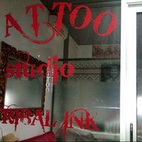 Photo taken at Tribal Ink Tattoo Studio by Majid Herciandy S. on 7/17/2012