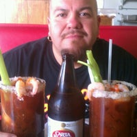 Photo taken at Burritos Clasico by Adrian V. on 9/11/2012