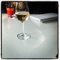 Photo taken at Black & White Cafe by Karina A. on 4/3/2012
