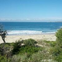 Photo taken at Zenith Beach by Bartos T. on 6/9/2012