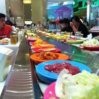 Photo taken at Shinyuu Shabu Shabu & Okonomiyaki by Paisan S. on 2/21/2012