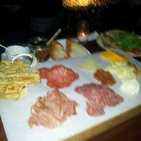 Photo taken at DOC Wine Bar by Therese M. on 2/4/2012