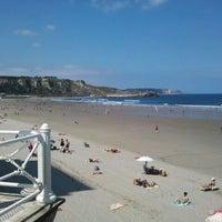 Photo taken at Playa de Salinas / San Juan de Nieva by Isaac M. on 8/7/2012