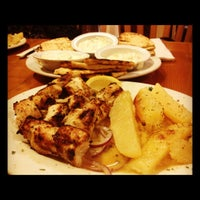 Photo taken at Avli Little Greek Tavern by Janine on 8/1/2012