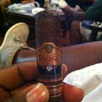 Photo taken at Fume Cigar Shop & Lounge by Lboggiee1 C. on 7/23/2012