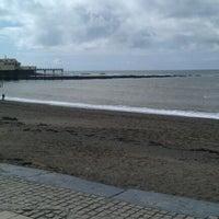 Photo taken at Aberystwyth Beach by Matt B. on 4/22/2012