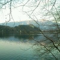 Photo taken at Blejsko Jezero / Lake Bled by Siniša K. on 3/25/2012