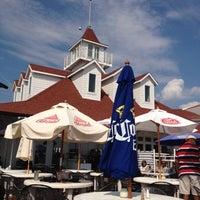 Photo taken at Rick's Cafe Boatyard by Tom M. on 6/10/2012