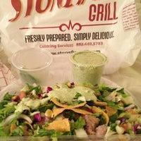 Photo taken at Stonefire Grill by LoveLilyStarGazers on 3/9/2012