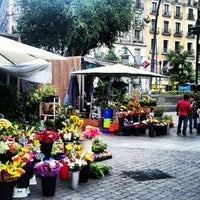 Photo taken at Plaza de Tirso de Molina by Alex G. on 7/26/2012