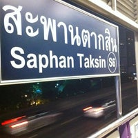 Photo taken at BTS Saphan Taksin (S6) by PiPe L. on 7/21/2012