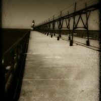 Photo taken at St. Joseph North Pier (at Tiscornia Park) by Julieanna D. on 6/25/2012