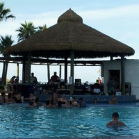 Photo taken at Pearl South Padre Swim-up Bar by MJR on 8/4/2012
