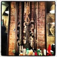 Photo taken at Mudhoney Salon by Alex A. on 3/3/2012