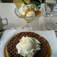 Photo taken at Crepes & Waffles by Regina V. on 8/15/2012