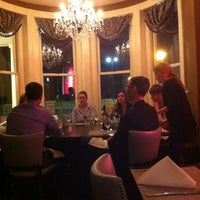 Photo taken at Mansion Five 26 by Amy S. on 3/22/2012
