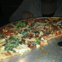 Photo taken at Bad Horse Pizza by Alandis B. on 3/25/2012