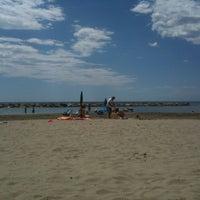 Photo taken at Spiaggia Santo Stefano Al Mare by Giuliano G. on 7/22/2012