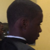 Photo taken at Headz Up Beauty and Barber Shop by Shenika T. on 6/9/2012