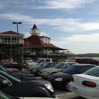 Photo taken at Rick's Cafe Boatyard by Scotty A. on 4/3/2012