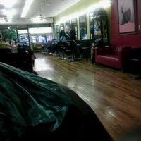 Photo taken at De Lux Natural Hair Gallery by Aidah Z. on 5/23/2012