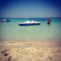 Photo taken at Spiaggia di Mondello by Elia on 6/12/2012