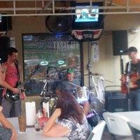 Photo taken at Pott's Sports Cafe by Richie G. on 8/17/2012