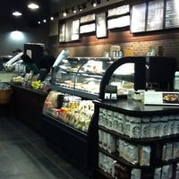 Photo taken at Starbucks by J K. on 3/21/2012