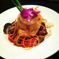 Photo taken at Osha Thai Noodle Cafe by Ashley P. on 4/6/2012