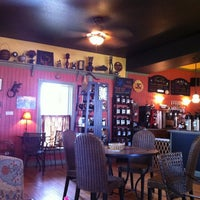 Photo taken at Dancing Turtle Coffee Shop by Emily on 8/14/2012