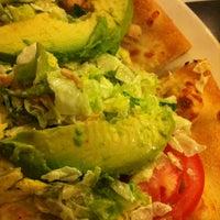 Photo taken at California Pizza Kitchen by Carolina H. on 3/26/2012