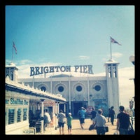 Photo taken at Brighton Palace Pier by Adam P. on 7/4/2012