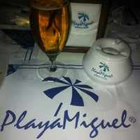 Photo taken at Playa Miguel Beach Club by Mititelu on 8/1/2012