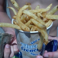 Photo taken at Thrasher's French Fries by Marci S. on 8/16/2012