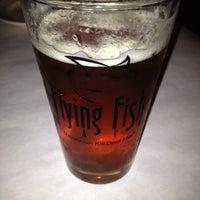 Photo taken at Flying Fish Cafe & Wine Bar by Jennifer L. on 4/12/2012