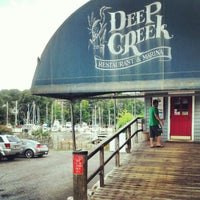 Photo taken at Deep Creek Restaurant and Marina by Owen I. on 8/11/2012