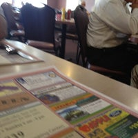 Photo taken at Village Green Restaraunt by Johnny D H. on 3/15/2012