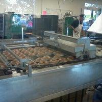 Photo taken at Krispy Kreme Doughnuts by Alex T. on 7/13/2012