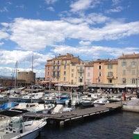 Photo taken at Port de Saint-Tropez by Emily E. on 6/11/2012